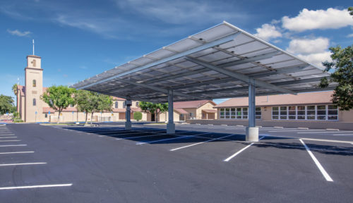 double cantilever commercial solar carport structure under view in church paring lot
