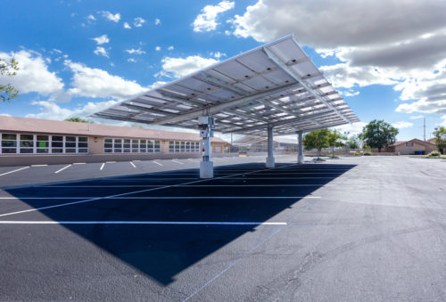 double cantilever commercial solar carport structure long shot view in church paring lot