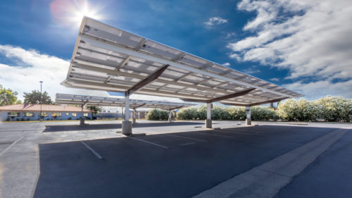 under view of inverted cantilever commercial solar carport in Fresno at San Joaquin High School