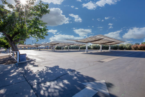 inverted cantilever commercial solar carport, solar panel canopy, at San Joaquin High School, full parking lot view