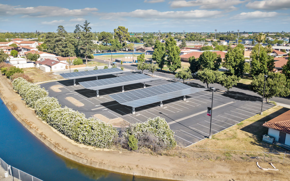 Inverted Cantilever commercial solar carport, solar panel canopy, school parking lot