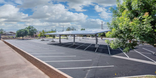 double cantilever commercial solar carport side view in parking lot
